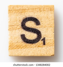 Los Angeles, CA/USA 02/24/2019 Wooden Scrabble letter S on white background from above