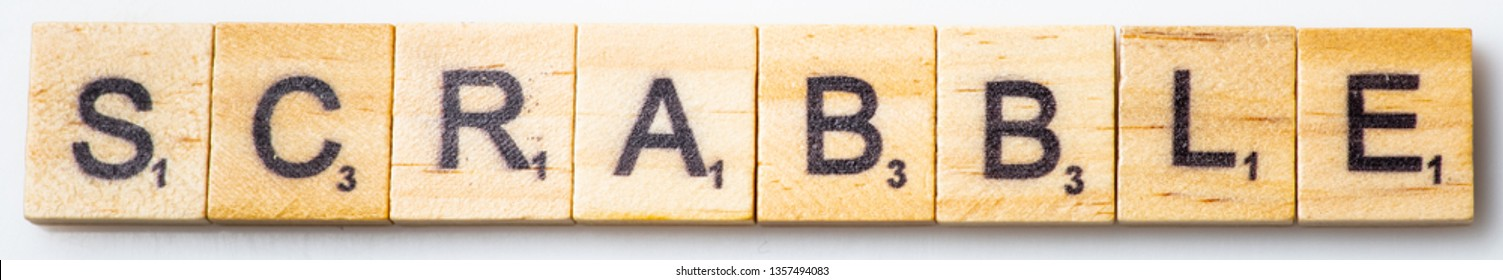 Los Angeles, CA/USA 02/26/2019 Word SCRABBLE in scrabble tiles from above on white background