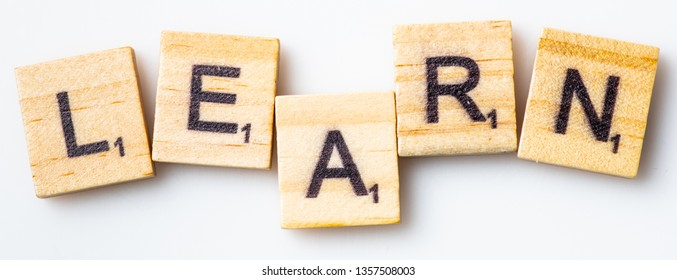 Los Angeles, CA/USA 02/26/2019 Word LEARN in scrabble tiles from above on white background
