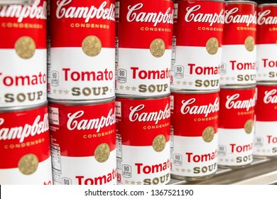 Los Angeles, CA/USA 04/03/2019 Tin cans of Campbell's tomato soup for sale in a supermarket shelf