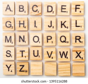 Los Angeles, CA/USA 05/11/2019 Complete Scrabble letter English alphabet uppercase on white background