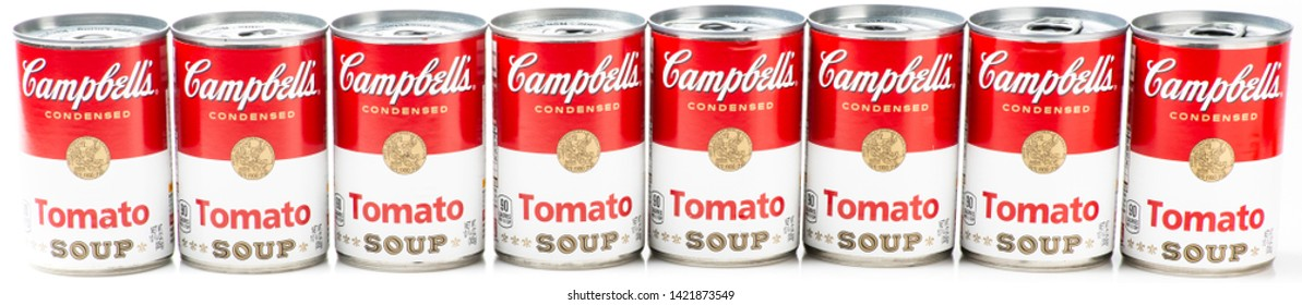 Los Angeles, CA/USA 06/11/2019 Eight can tins of Campbell's brand tomato soup on white background