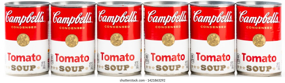Los Angeles, CA/USA 06/11/2019 Six can tins of Campbell's brand tomato soup on white background