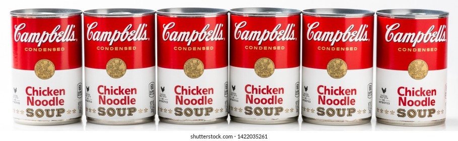 Los Angeles, CA/USA 06/11/2019 Six can tins of Campbell's brand chicken noodle  soup on white background