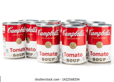Los Angeles, CA/USA 06/11/2019  Ten can tins of Campbell's brand tomato  soup on white background