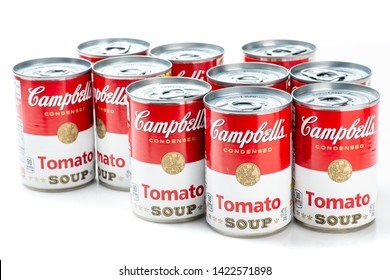 Los Angeles, CA/USA 06/11/2019. Ten can tins of Campbell's brand tomato  soup on white background