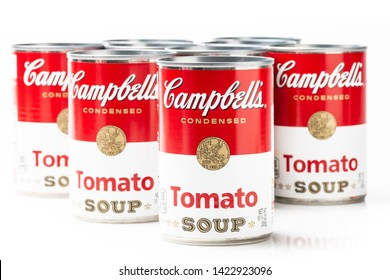 Los Angeles, CA/USA 06/12/2019. Can tins of Campbell's brand tomato soup on white background