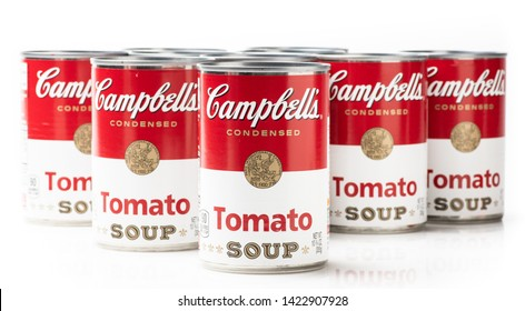 Los Angeles, CA/USA 06/12/2019. Eight can tins of Campbell's brand tomato soup on white background