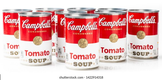 Los Angeles, CA/USA 06/12/2019. Nine can tins of Campbell's brand tomato soup on white background