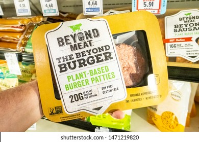 Los Angeles, CA/USA 08/03/2019    Shoppers hand holding a package of Beyong Meat brand plant based burger patties in a supermarket aisle