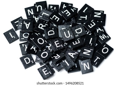 Los Angeles, CA/USA 09/4/2019 Heap of Black Wooden Scrabble letters uppercase on white background