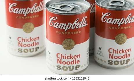 Los Angeles, CA/USA 11/5/2019 Tin cans of Campbells brand Chicken Noodle Soup on White Background