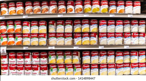 Los Angeles, CA/USA 6/1/2019 -Assorted Campbells brand soups and creams cans tins for sale in a supermarket aisle