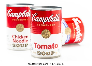 Los Angeles, CA/USA 6-21-2019 Three can tins of Campbell's brand tomato soup, chicken noodle soup and cream of mushrooms  soup on white background