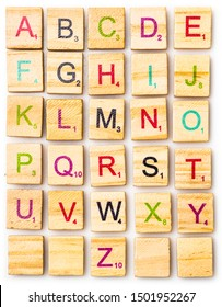 Los Angeles, CA/USA 9/11/2019 Complete Colored Scrabble letter English alphabet uppercase on white background