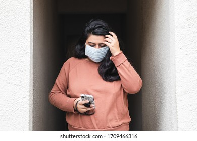Los Angeles, Ca/USA - April 20, 2020: A millennial wearing a medical face mask while driving. Wearing recommended face mask during the coronavirus outbreak and global pandemic