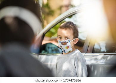 Los Angeles, Ca/USA - April 20, 2020: A young child wearing a home made face mask while outside during the global pandemic. Social distancing to fight COVID-19.