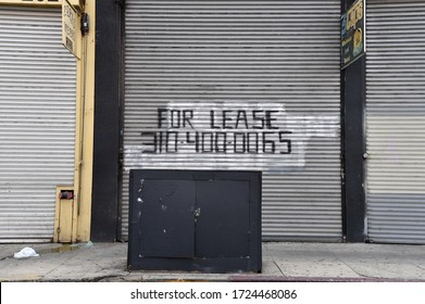 Los Angeles, CA/USA - April 28, 2020:  Boarded up shops during coronavirus are now going up for lease as businesses announce they will not be able to reopen