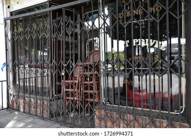 Los Angeles, CA/USA - April 9, 2020: Bars accross a sidewalk cafe and restaurant closed during coronavirus quarantine