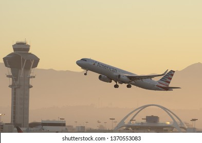 LOS ANGELES, CA/USA - AUGUST 16, 2015: image of an American Airlines Airbus A321 shown taking off from the Los Angeles International Airport, LAX, at sunrise.