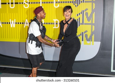 LOS ANGELES, CA/USA - AUGUST 30 2015: Tyga, left and Kris Jenner attend the 2015 MTV Video Music Awards at Microsoft Theater.