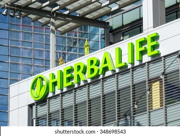 LOS ANGELES, CA/USA - December 6, 2015: Herbalife building and logo. Herbalife International is a multi-level marketing company that sells nutrition, weight management and skin-care products.