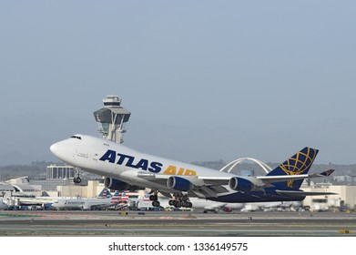 LOS ANGELES, CA/USA - FEBRUARY 11, 2018: Atlas Air jet (Boeing 747) shown taking off from LAX, Los Angeles International Airport. Atlas Worldwide Holdings is a cargo and passenger charter airline.