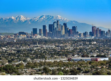 Los Angeles, CA/USA - February 26, 2019: Record snowfall in February leaves high amounts of snow in San Gabriel Mountains behind skyscrapers in downtown Los Angeles, California