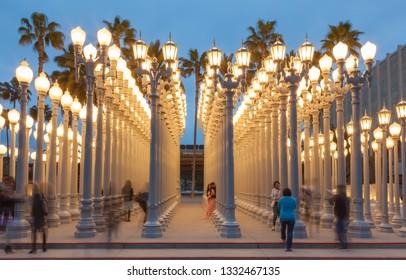 "Los Angeles, CA/USA - February 28, 2019: Chris Burden's public art piece ""Urban Light"" at LACMA, the Los Angeles County Museum of Art."