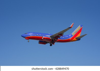 LOS ANGELES, CA/USA - JANUARY 24, 2016: Southwest Airlines Boeing B737 (reg N251WN) shown shortly before landing at the Los Angeles World Airport. Southwest  is the world's largest low-cost carrier.