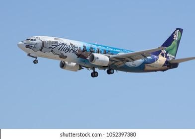 LOS ANGELES, CA/USA - JULY 10, 2015: 'Spirit of Alaska Statehood' Alaska Airlines jet (Boeing 737, registration N705AS ) shown arriving at  the Los Angeles International Airport (LAX).