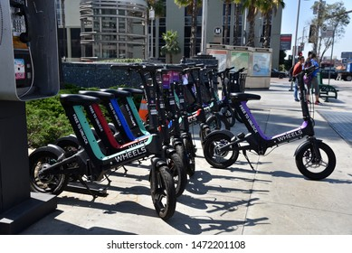 LOS ANGELES, CA/USA - JULY 10, 2019: Mini Electric Bicycles near the Metro Station are replacing rental bikes