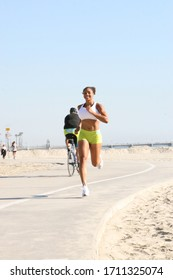 Los Angeles, CA-USA June 15, 2011 Young woman going for a routine run at the beach.