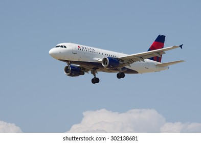 LOS ANGELES, CA/USA - JUNE 6 2015: Delta Airlines Airbus A319 (registration N354NB) in flight shortly before landing at the Los Angeles World Airport (LAX).