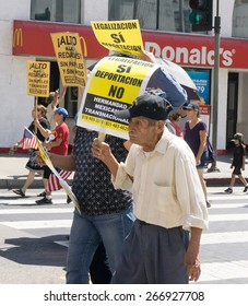 LOS ANGELES, CA/USA - MARCH 28, 2015:  Unidentified participants in an immigration reform rally in the United States.