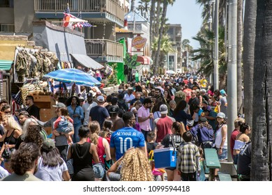 LOS ANGELES, CA/USA - MAY 27, 2018: Throngs of people flock to the famous Venice Beach Boardwalk for Memorial Day Weekend