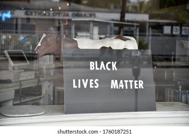 Los Angeles, CA/USA - May 30, 2020: A Third Street business with a Black Lives Matter sign in their window during the riots over the George Floyd killing in the Fairfax District