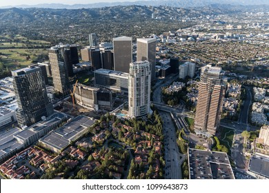 Los Angeles Century City skyline aerial view with Beverly Hills and the Santa Monica Mountains in background.