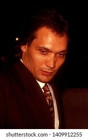 LOS ANGELES - circa 1991:  Actor Jimmy Smits and his girlfriend Wanda DeJesus leave Spago restaurant.