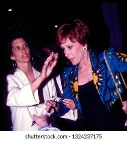 LOS ANGELES - circa 1991: Carol Burnett hurries through a crowd of fans leaving Spago restaurant.