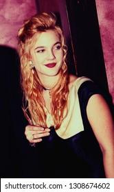 LOS ANGELES - circa 1991: Drew Barrymore leaves Roxbury nightclub.