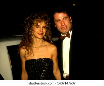 Los Angeles - circa 1991:  John Travolta and his wife Kelly Preston depart Spago restaurant.