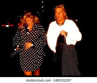 LOS ANGELES - circa 1992:  Rod Stewart and wife Rachel Hunter go dotty leaving Le Dome restaurant in polka dot fashion.