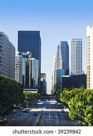 Los Angeles city skyline on a sunny day with blue sky.