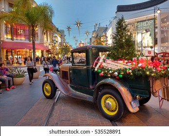 LOS ANGELES, DEC 10TH, 2016: A classic Ford pick-up truck decorated with holiday lights sits on the trolley tracks at the famous Grove shopping center at the Fairfax district during the holidays.