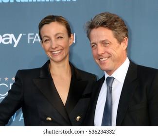 LOS ANGELES - DEC 11:  Anna Elisabet Eberstein, Hugh Grant at the 22nd Annual Critics' Choice Awards at Barker Hanger on December 11, 2016 in Santa Monica, CA