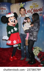 """LOS ANGELES - DEC 11:  Eric Winter, Sebella Winter, Roselyn Sanchez, Minnie Mouse at the """"Disney on Ice"""" Red Carpet Reception at the Staples Center on December 11, 2014 in Los Angeles, CA"""