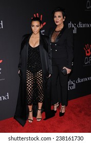LOS ANGELES - DEC 11:  Kim Kardashian & Kris Jenner arrives to the The First Annual Diamond Ball on December 11, 2014 in Beverly Hills, CA