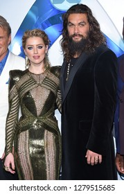LOS ANGELES - DEC 12:  Amber Heard and Jason Momoa arrives to 'Aquaman' Hollywood Premiere  on December 12, 2018 in Hollywood, CA