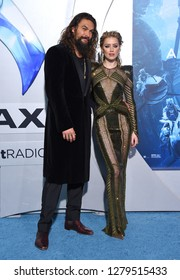 LOS ANGELES - DEC 12:  Jason Momoa and Amber Heard arrives to 'Aquaman' Hollywood Premiere  on December 12, 2018 in Hollywood, CA